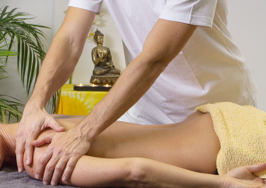 Main Difference - Massage vs Reflexology